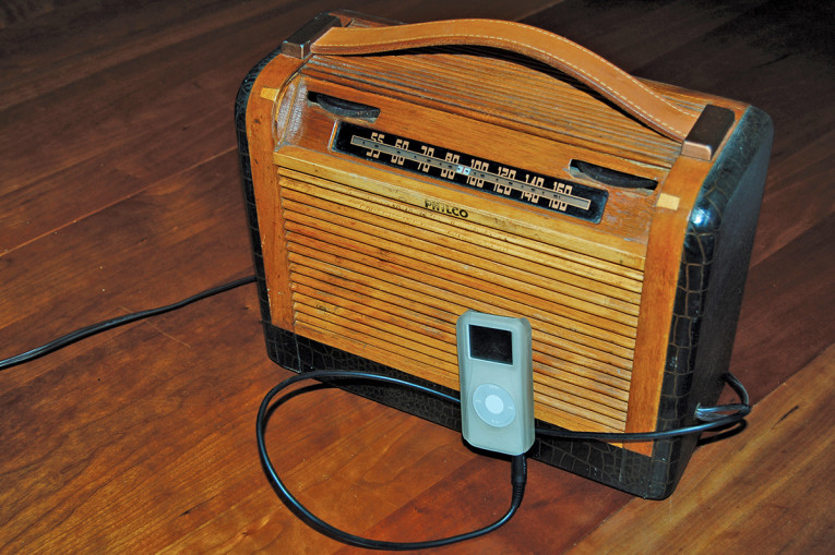photo 1: a 1948 philco portable tube radio restored and repurposed as an  amplifier, connected to a (now also vintage   ) ipod digital player