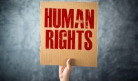 Man holding cardboard paper with HUMAN RIGHTS title thumb