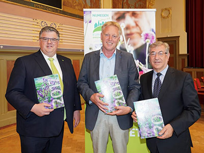 Frans Schepers, Managing Director of Rewilding Europe (centre) presents Karmenu Vella, European Commissioner for Environment, Fisheries and Maritime Affairs (right) and Hubert Bruls, Mayor of Nijmegen (left) with a copy of the Rewilding Europe Annual Review 2017, prior to a ceremony announcing the European Green Capital for 2020 that took place in Nijmegen on June 21. (Photo: Jan Willem de Venster)