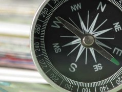 Compass points towards the west