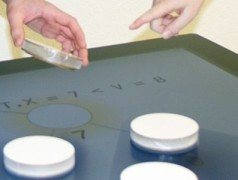 Tabula: trackable tangibles on multi-touch displays