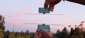 Battery-free Communication Devices Harvest Energy from Ambient Radio Signals