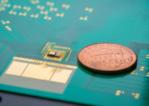 The wake-up chip is to the left of the penny. Image: David Baillot / UCSD.