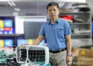 Xiaoyang Zeng in front of his 'Super Camera'. Image: Fudan University.