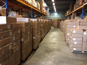 La cargaison d'imprimantes arrivées de Chine en début de semaine encombre les travées de notre stock.