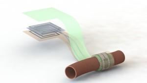 Artist impression van de bio-afbreekbare sensor die rond een bloedvat is gewikkeld. De verschillende lagen van de antenne zijn hier gescheiden getekend om de opbouw te verduidelijken (afbeelding: Levent Beker).