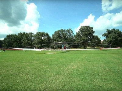 All solar-powered, piloted helicopter lifts off (1 foot)