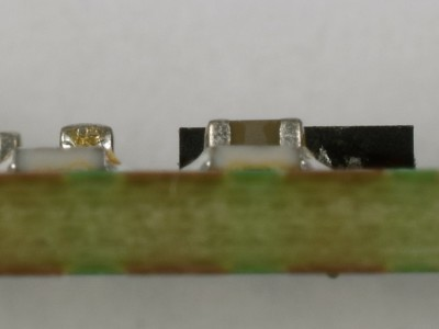 Side view of USB-RS232 converter PCB 180537-1 v1.0 with a socket connected to K2