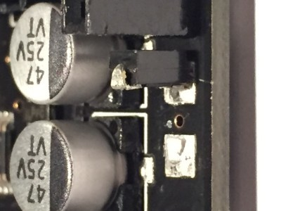 diode now standing upright on pad near shield connector