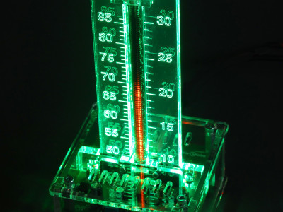With transparent enclosure, green scale backlighting