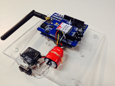 Close-up of the cellphone shield, servo, trigger switch and vibration motor