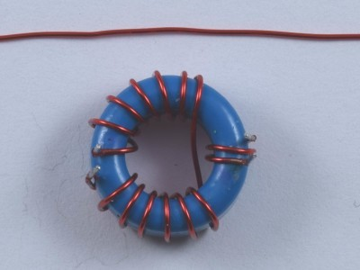 Bottom view of transformer TR1 with the piece of enameled wire left from 30 cm
