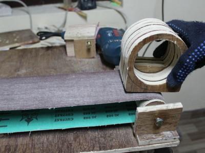 Sanding the outside surface with belt sander