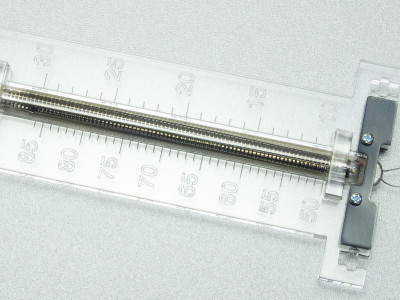 Laser cut acrylic scale with IN-9 tube mounted, front view