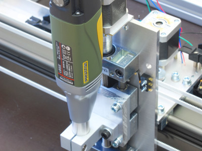 Z-axis mounted on the X-axis bridge using a piece of aluminum bar material