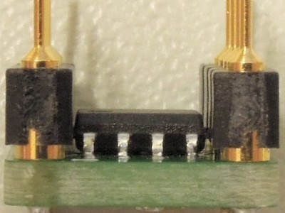 Side view of a finished adapter 150797-1 v1,0 with pin headers