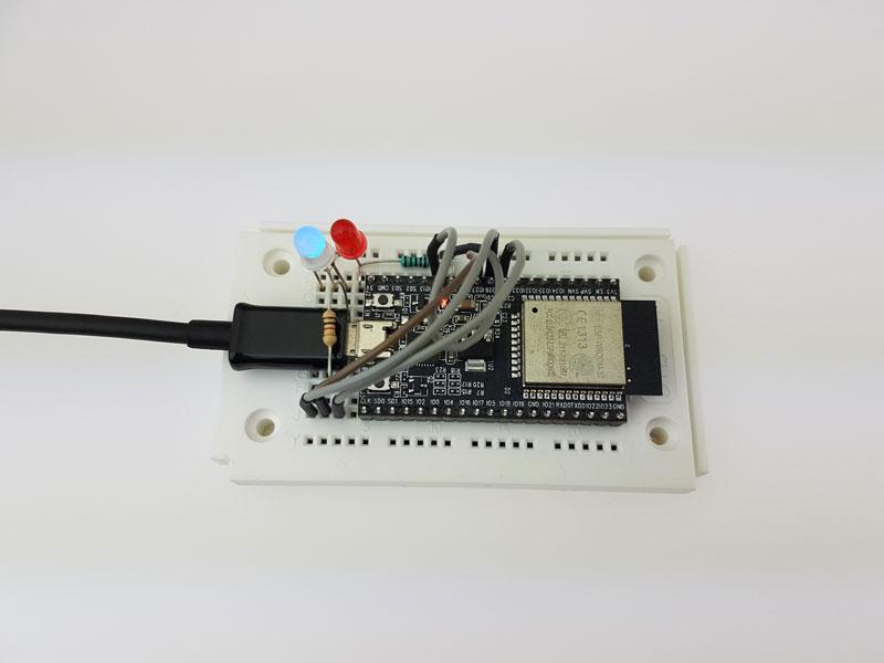 ESP32 Dev Kit C on breadboard with blue RGB LED