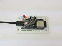 ESP32 Dev Kit C on breadboard with blue RGB LED thumb