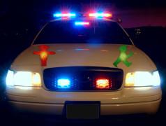 Patrol cars switch traffic signals