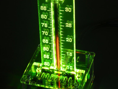 With transparent enclosure, yellow/green scale backlighting