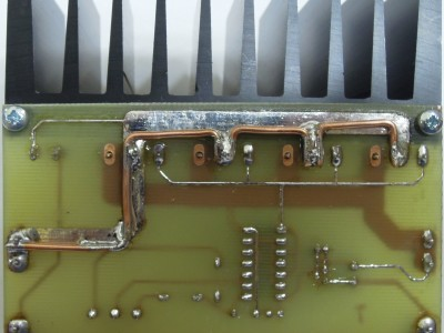 The solder side of the first prototype. The extra thicjk wires sodered to the tracks clearly vissible.