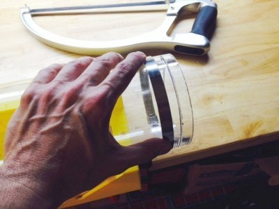 Cutting the acrylic tube with a hack saw.  You have to cut and rotate, cut and rotate.