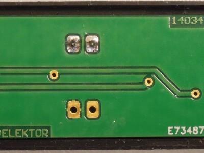 Bottom view of PCB 140344-1 v1.1 in black USB case