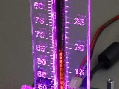 Working thermometer, purple background lighting